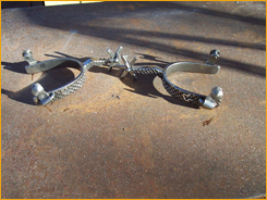 Vaquero Leg Spurs with Brand rowls